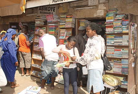 Shoppers at a bookstore in readiness for children's resumption back to school at Yaba, Lagos... yesterday. PHOTO: TOYIN AKHIEGBE