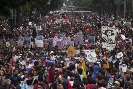 Thousands gather to mark the one-year anniversary of the disappearance of 43 students with a march in Mexico City, Saturday, Sept. 26, 2015.  PHOTO:  mycci