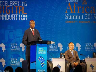 Rwanda's Prime Minister Anastase Murekezi (left) gives his opening remarks as Secretary General of the International Telecommunications Union, Houlin Zhao looks on during the Transform Africa Summit 2015 in Kigali            PHOTO: TIMOTHY KISAMBIRA