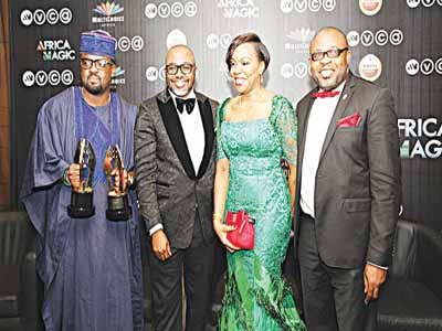 Kunle Afolayan (left), John Ugbe, Wangi Mba-Uzoukwu, and Kufre Ekanem, at the AMVCA 2015 in Lagos.