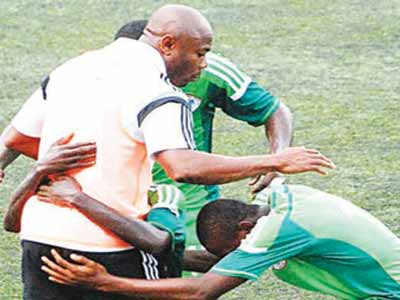 The players celebrate  with Coach Emmanuel Amuneke