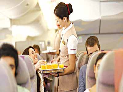 Passengers inside Emirates aircaft, having their drinks