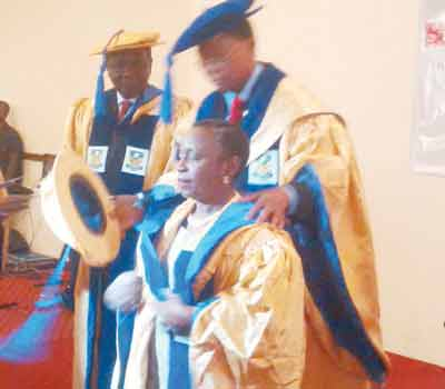 Former Head of State, General Yakubu Gowon looks on as former Health Minister and President Nigeria Academy of Pharmacy (NAP), Prince Julius Adelusi-Adeluyi confers Dean Faculty of Pharmacy University of Lagos, Prof. Olukemi Odukoya with Fellow of the Academy PHOTO: WOLE OYEBADE