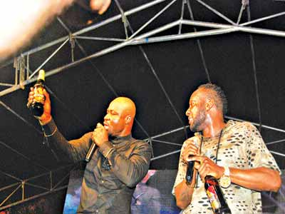 Harrysong and Kcee on stage.