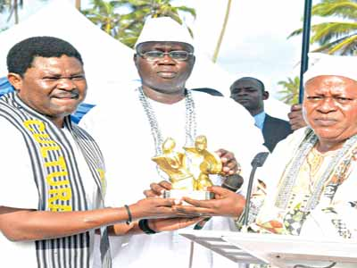 Actor Yomi Fash (left), Otunba Gani Adams and a guest at the event.