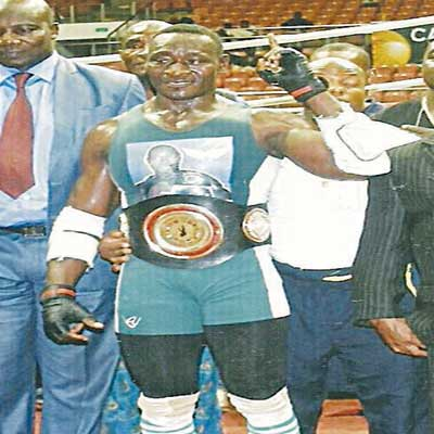 Nigeria's Power Lee (second left) after winning the 'Battle of Yaounde' on September 19. The new African champion will fight with Angola's Marvelous Buffalo in Asaba…on November 1.