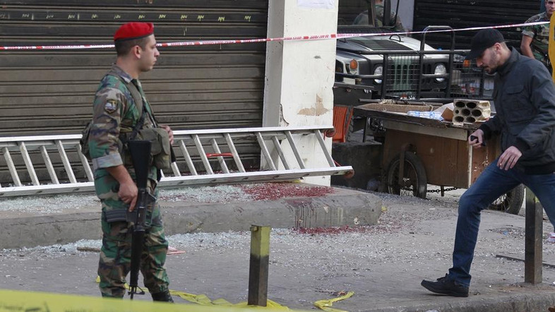 """A Lebanese army soldier secures the area as blood stains are seen on the ground at the site of the two explosions that occured on Thursday in the southern suburbs of the Lebanese capital Beirut, November 13, 2015. Lebanon observed a national day of mourning on Friday after two suicide bombs the day before killed 43 people in southern Beirut, in an act the United Nations condemned overnight as """"despicable."""" REUTERS/Aziz Taher"""