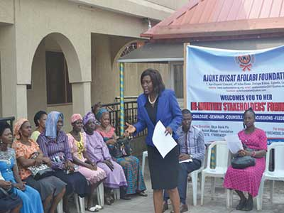 Mrs. Foluke Ademokun, executive coordinator of the Ajoke Ayisat Afolabi Foundation (AAAF) with the widows.