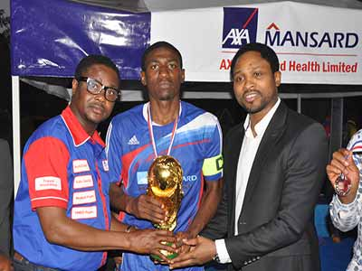 Head of Operations, AXA Mansard Health, Nte Uran-York (left), Captain Society For Family Health Football Team/Winner of 2015 Federation of International Development Agencies Football (FIDAF) Tournament, Suleman Tukur, and Celestine Babayaro, who was the Special Guest of Honour, during the cup presentation at the 2015 FIDAF tournament in Abuja…at the weekend.