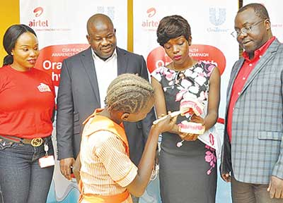 (L-r): Chioma Okolie, assistant CSR manager, Airtel; Oladokun Oye, regional operations director, Airtel, Lagos Region; Abu Dorcas, member, Nigerian Dental Association (NDA); Sola Adeyemi, vice president, Licensing, Compliance and Carrier Relations, Airtel, with a student of Oremeji Primary School II demonstrating how to brush during the Airtel-Unilever Oral Health Hygiene programme in Lagos recently.