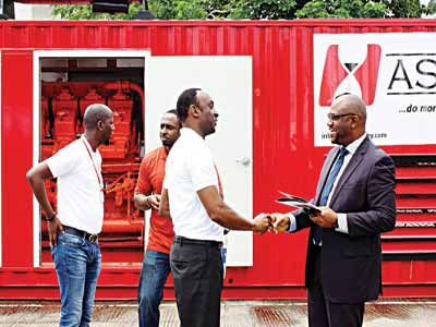 General Manager, Operations, Asiko Energy, Motunde Hassan; and Executive Director, Asiko Energy, Martin Ekundayo, explaining the benefits of switching from diesel to the ASIKO gas powered industrial IPP generator LPGAS expo recently.