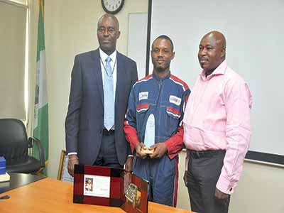 THE 2014 Award of Excellence from Toyota Nig Plc. was presented by RT Briscoe Plc. to one of its workers, Odiboh Julius Omoijade.