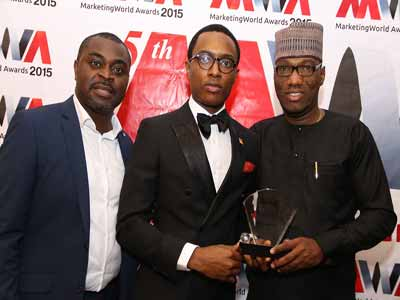 Publisher, Marketing World Magazine, Akin Naphtal (left); Group Head, Corporate Communications, BUA Group, O'tega Ogra; and Special Assistant to the Executive Director, BUA Group, Gbolly Oluwasegun, at the fifth Edition of Marketing World Awards 2015, where BUA Cement won the Cement Brand of the Year Award.