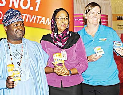 Immediate past President, Pharmaceutical Society of Nigeria (PSN), Olumide Akintayo; Head of Procurement, Federal Ministry of Health, Rukiyat Odekunle; and Marketing Manager South Africa, Pfizer Consumer Healthcare, Sue Cartwright during the launch of Centrum and Caltrate products at the PSN National Conference in Abuja
