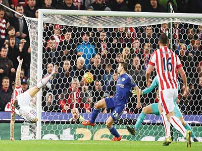 Stoke City's Austrian striker Marko Arnautovic (left) shoots to score the opening goal of the English Premier League football match between Stoke City and Chelsea at the Britannia Stadium in Stoke-on-Trent, central England. PHOTO: AFP