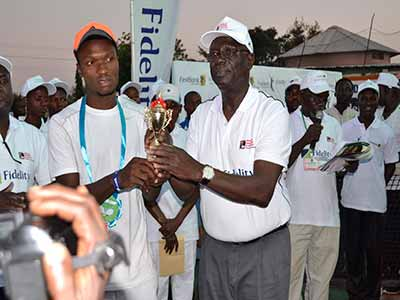 NTF President, Sani Ndanusa (right), presenting the men's singles runner-up trophy to Michael Moses at the end of the Dala Hard Court Tennis Championship held at the Kano Polo Club… at the weekend.