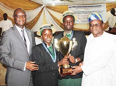 Permanent Secretary, Lagos State Ministry of Agriculture, Dr. Yakub Olajide Basorun (left), Miss Halimat Lawal and Miss Rukayat Yusuf of Ansar-Ud-Deen Senior Girls' High School, Itire, Lagos State, and Chairman, Board of Trustees, Younis Olatunji Basorun Education Foundation (YOBEF), Chief Abayomi Aiyepola, during the presentation of trophy to the winners of the 2015 YOBEF Schools' Debate