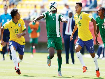 Nigerian Funsho Bamgboye (centre) vies for the ball with Brazilian Dodo (left) and Guilherme during their FIFA U-17 World Cup match in Vina del Mar, Chile… on Sunday. PHOTO: AFP.