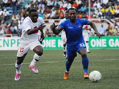 Enyimba defender, Ugwu Uwadiegwu (right), tries to outwit Enugu Rangers' Chisom Egbuchulam during their 2014/2015 NPFL game at the Nnamdi Azikiwe Stadium, Enugu. PHOTO: LMC