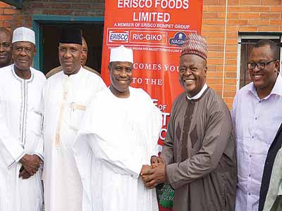 The Executive Director, Erisco Foods Limited, Nnaemeka Umeofia (right), President/Chief Executive Officer, Erisco Foods Ltd,  Chief Eric Umeofia; welcoming Executive Governor of Sokoto State, Alhaji Aminu Waziri Tambuwal; Sokoto Commissioner for Commerce, Aminu Bello and a state assembly member during a factory tour of Erisco Foods in Lagos.