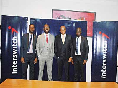 Yemi Adegoke (SlimTrader) (left), Femi Akinde SlimTrader, Mitchell Elegbe (Interswitch) and Jonah Adams (Interswitch)