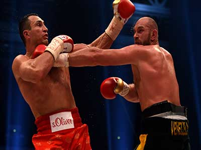World heavyweight boxing champion Wladimir Klitschko (left) of Ukraine defends against Britain's Tyson Fury during their WBA, IBF, WBO and IBO title bout in Duesseldorf, western Germany, on Saturday. Fury dethroned Klitschko in a 12 round decision to become new world heavyweight champion.