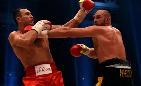 Tyson Fury (R) was awarded the fight in Duesseldorf 115-112, 115-112 and 116-111 by the judges PHOTO: AFP