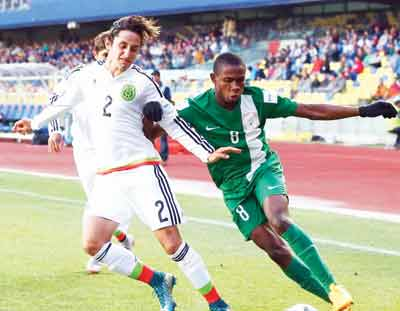 It's my ball….This Golden Eaglet seems  to tell his Mexican challenger in Thursday's semifinal of the FIFA U-17 World Cup. Nigeria won 4-2