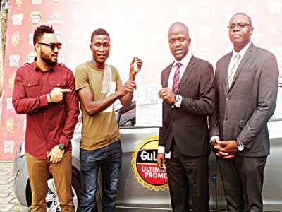 Gulder Brand Ambassador, Lil Rhymz (left); winner of a brand new Hyundai Elantra in the ongoing Gulder Ultimate Promo, Abayomi Gbenga; Marketing Manager, Gulder, 33, Life, More and stout category, Emmanuel Agu; and Senior Brand Manager Gulder, Onyeka Okoli both of Nigerian Breweries Plc during the prize presentation at the company's headquarters, Iganmu-Lagos...recently.