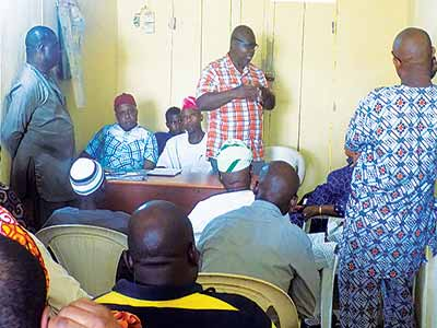 Joint CDA Chairman, Alhaji Bashir Adejumo (right); member, House of Assembly, Jude Idimogu, community leader, Val Nwachukwu and others at the peace meeting held with the judgment creditors and their representatives on Sunday at Ejigbo police station.
