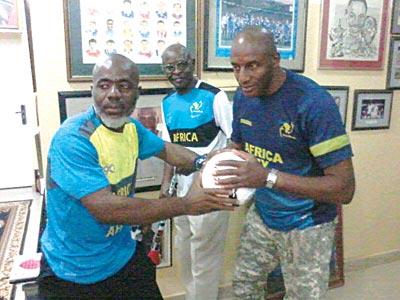 Sam Obu (left) with ex-footballer John Fashanu.
