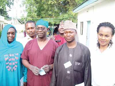 Fatima Rafindadi, of Vision FM Abuja, (left), Dr. Amir Imam Yola, Surgeon, Laure Fistula Centre in Murtala Muhammed Teaching Hospital Kano, Abdulrosheed Okiki, Radio Kwara, Ilorin, and Eberechukwu Diokpo, Project Officer, Fistula Care Plus, during a Journalists Working Visit to the Hospital in Kano, recently. PHOTO: PAUL ADUNWOKE