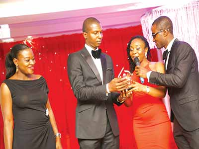 Osula and his wife, Ivie (left) receiving the award w at the event