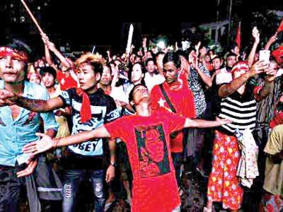 Supporters of Myanmar's pro-democracy figurehead Aung San Suu Kyi gather outside National League for Democracy headquarters (NLD) in Yangon, Myanmar.