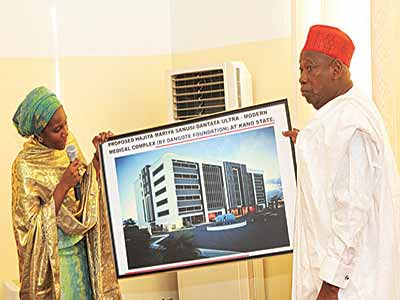 Executive Director Dangote Foundation, Hajiya Halimat Dangote (left) presenting the prototype of Hajiya Mariya Sanusi Dantata Ultra Modern Medical Complex financed by Dangote Foundation to Kano State Governor, Dr. Abdullahi Umar Ganduje during a visit to the Government House, Kano at the weekend.