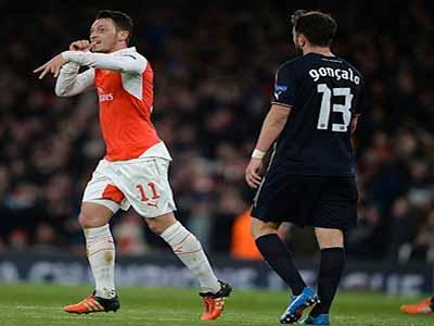 Mesut Ozil celebrates scoring Arsenal's opening goal against Dinamo Zagreb at the Emirates Stadium. Photo: Dailymail.co.uk