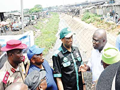 Lagos State Governor, Akinwunmi Ambode (right); Secretary to the State Government, Tunji Bello; Commissioner for the Environment, Babatunde Adejare and the state Sector Commander, Federal Road Safety Commission (FRSC), Hyginus Omeje, during the governor's inspection tour of Ladipo Canal on Oshodi-Apapa Expressway… yesterday.