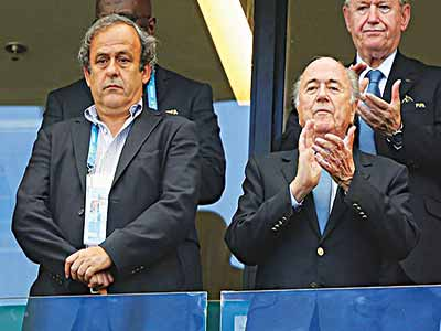 Mitchel Platini (left) and Sepp Blatter.