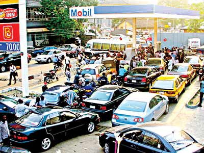 Long queues at a filling station.