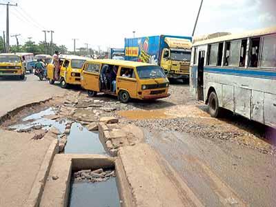 Bad spots at Ilasa Bus Stop, Oshodi Apapa Expressway, Lagos
