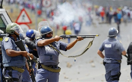South African police clash with strikers at parliament