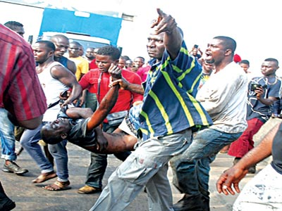 One of the victims taken out by rescuers. PHOTOS: FEMI ADEBESIN-KUTI and SUNDAY AKINLOLU