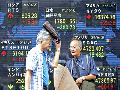Electronic board showing stock market indices of various countries in Tokyo, Japan