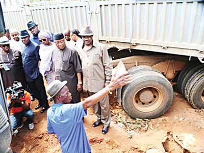 Committee members at the spot where the truck blocked the Ohafia-Arochukwu federal road