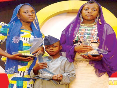 13 year old IIDA First place winner from Kano state (left), Abbas Naifarya Ibrahim; seven year old second place winner from Abuja, Innocent Yamawo and third place winner, 12 year old Naja Nuhu.