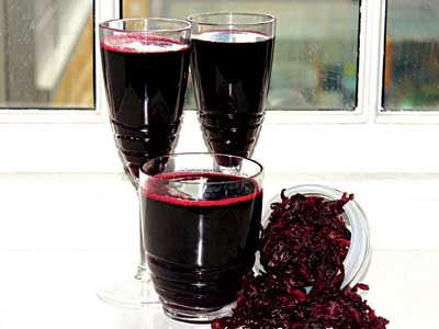 Zobo drink (inset is Hibiscus sabdariffa plant showing the leaves and flower).