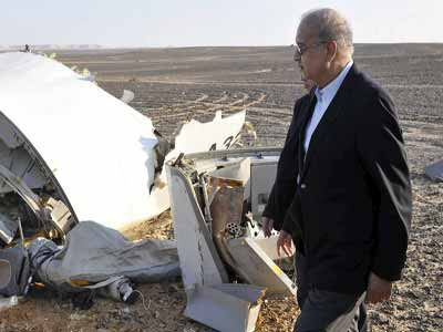 Egypt's Prime Minister Sherif Ismail looking at the remains of a Russian airliner after it crashed in central Sinai near El Arish city, north Egypt, on Saturday.  														      PHOTO: REUTERS/Stringer