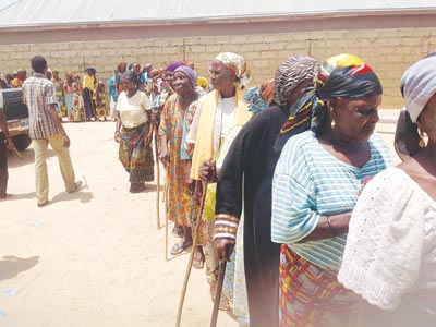 Old women waiting to receive donations from the Catholic Bishop of Yola, Steven Dami Mamza. PHOTO: EMMANUEL ANDE