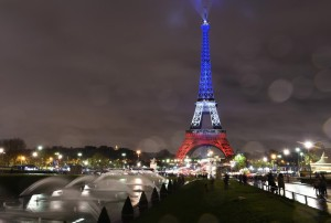 A photo taken on November 17, 2015 in Paris shows the Eiffel Tower illuminated with the French national colors in tribute to the victims of the November 13, 2015 Paris terror attacks. AFP PHOTO / BERTRAND GUAY (Photo credit should read BERTRAND GUAY/AFP/Getty Images)