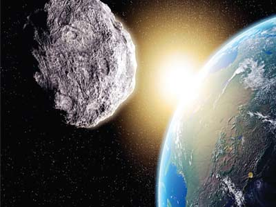 Giant asteroid...the asteroid 163899, also known as 2003 SD220, will pass by Earth at a harmless distance of 6.7 million miles- that is about 28 times as far as the moon. It is a big asteroid, estimated to be between 0.5 and 1.5 miles wide, and it is zooming around at about 5 miles per second.  PHOTO: google.com/search